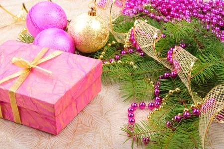 pink and green: christmas pink and gold decorations on green pine branch