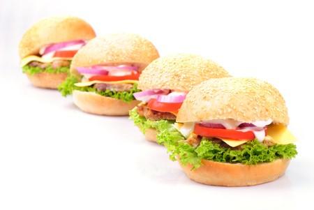 four homemade hamburgers isolated on white background photo