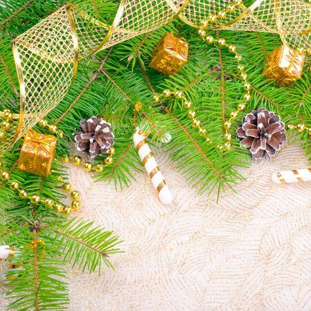 copysapce: Gold Christmas ribbon, balls and beads on green pine branch
