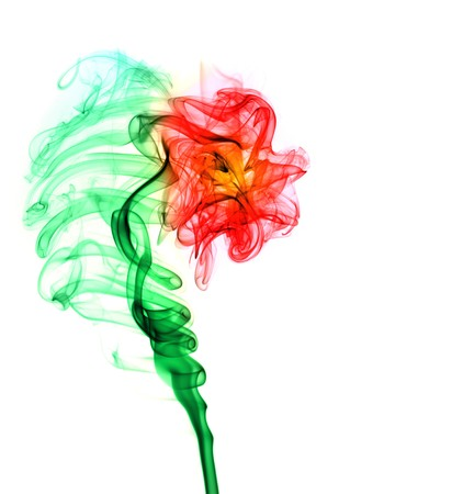 Abstract multi colored smoke puff  in form of flower isolated on white photo