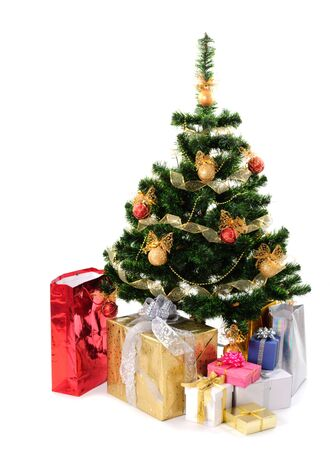 solemnity: christmas tree with different gifts isolated on white