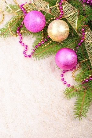 christmas beads: christmas pink and gold decorations on green pine branch