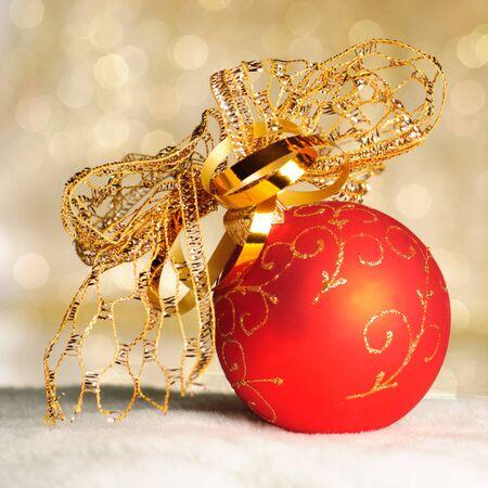 Red Christmas ball ornwhite fur of defocused golden lights. Shallow DOF.  Stock Photo - 8387737