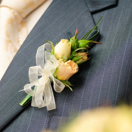 Wedding posy on the lapel of grooms jacket photo