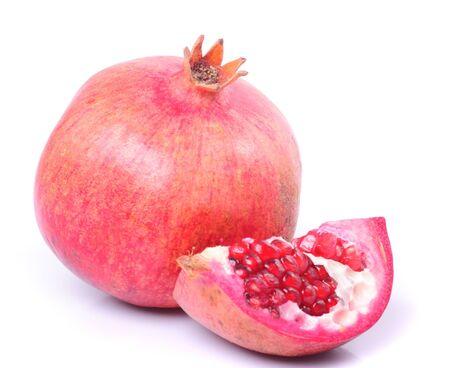 pomergranate: Pomergranate and slice isolated on white background