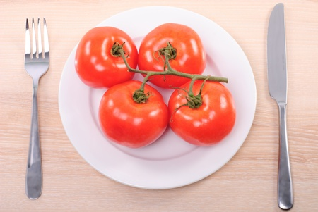 Concept of tomato diet with plate on wooden table Stock Photo - 8602964