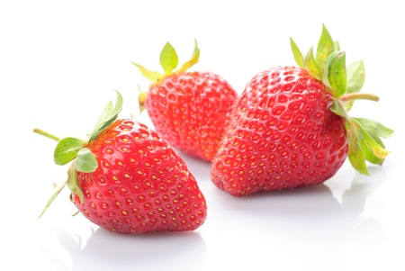strawberries: Group of fresh strawberries whith grean leaf on white