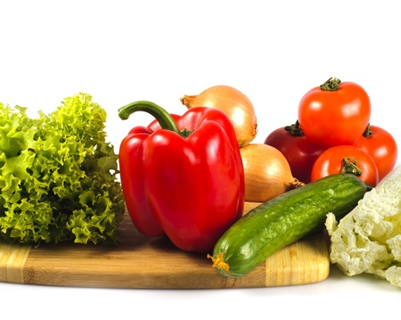 Vegetables in kitchen for salad, isolated on white photo