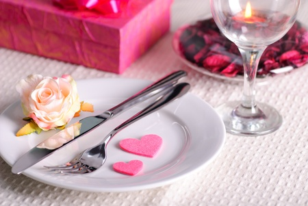 Valentine's dinner waitnig for couple, present and candle included Stock Photo - 8748043