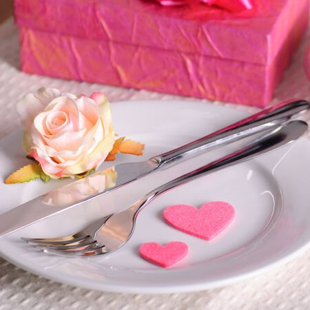 Valentines dinner waitnig for couple, present and candle included photo