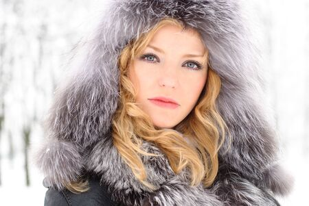 winter day: Blond woman outdoors in winter day