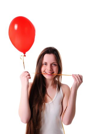 Girl with red balloon heart isolated on white photo