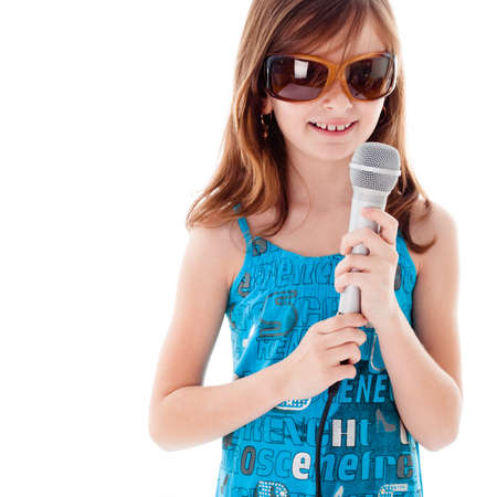 Girl are singing a song. Isolated on white photo