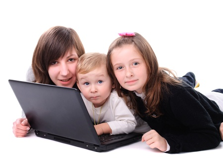Three children play with laptop, isolated on white photo