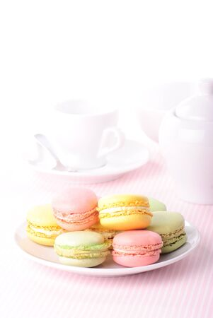 Pink macaroones in row close up photo