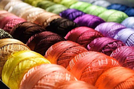 Different color threads on rows in the store Stock Photo - 9087025