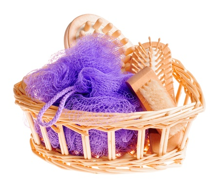 Bath anti-cellulitis spa massage kit with comb, brush, sponge and hairbrush in basket isolated on white background Stock Photo - 9252941