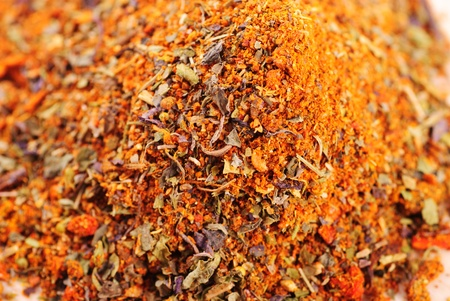 spicery: Mixed spicery heap on the wooden table in kitchen