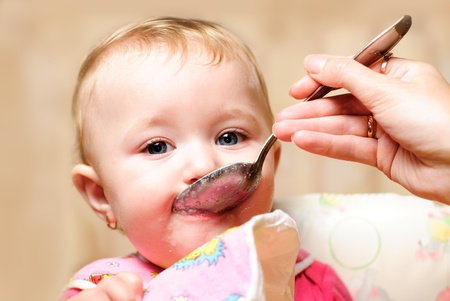 Girl are eating a food from spoon  photo
