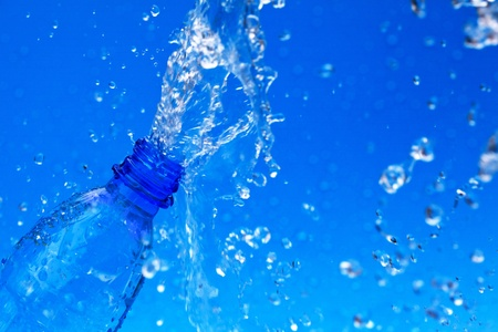 splash water from bottle on blue Stock Photo - 9565804