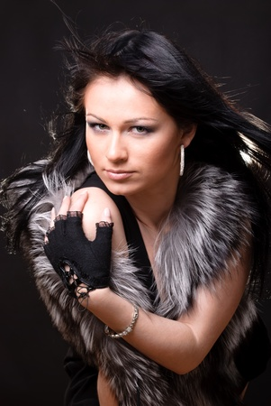 Woman in fur coat on black backgound Stock Photo - 9565824