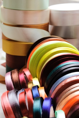 art and craft equipment: many-coloured ribbon spools in the craft