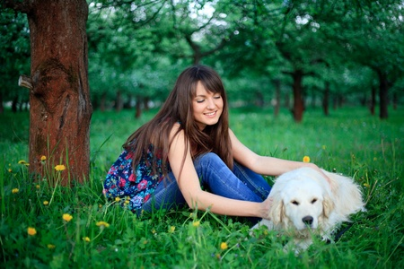 pillowy: Girl play with golden retriever in park