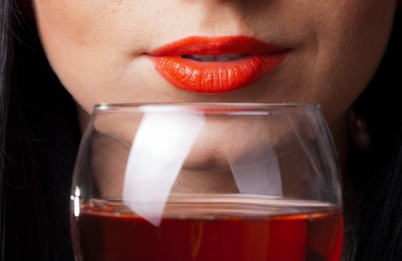 Red lips and glass of wine close up Stock Photo - 9619306