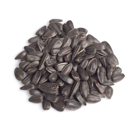 black seeds: Sunflower seeds isolated on white
