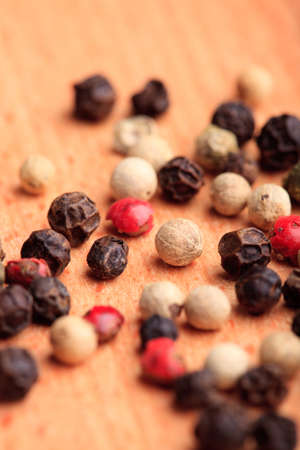 Different peppercorns on wooden table close up Stock Photo - 9681304