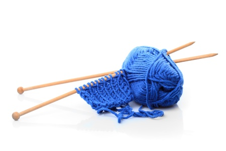 Knitting close up with blue woven thread isoalated on white Stock Photo - 9681288