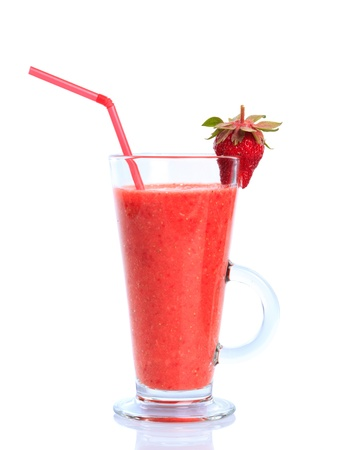 Strawberry smoothie isolated on white in glass photo