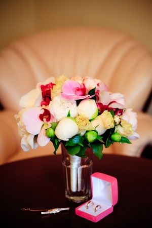 Wedding bouquet from orchids and peony on table photo