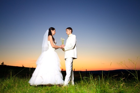 Wedding couple dansing in mountain hill on sunset Stock Photo - 9800739