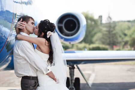 airplanes: Wedding couple are prepare to fly on a honeymoon trip