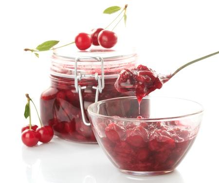 Cherry jam with fresh fruits isolated on white photo