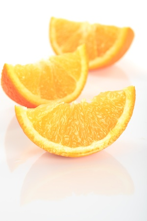 orange's parts isolated on white, prepared for juice Stock Photo - 9800878