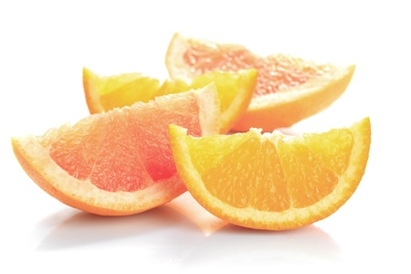 grapefruit's and orange's parts isolated on white, prepared for juice Stock Photo - 9800882