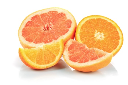 sweet segments: grapefruits and oranges parts isolated on white, prepared for juice Stock Photo