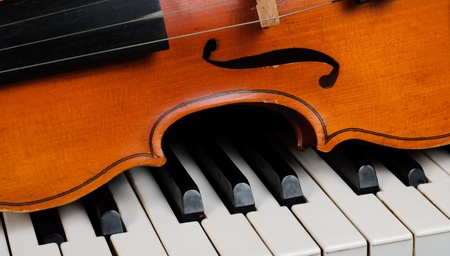 Violin and piano close up photo