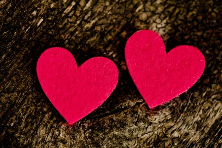 Red hearts stickers on wooden background  photo