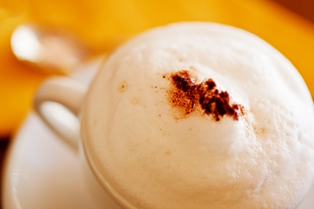 Cappuccino cup with high strong foam close up. Shallow deep of field Stock Photo - 10093153