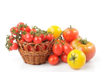 Various types of tomatoes  isolated on white background photo