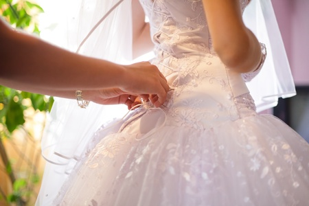 evening gown: Wedding lacing with hands close up