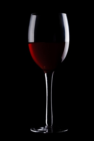 dark glasses: Glass with red wine isolated on black