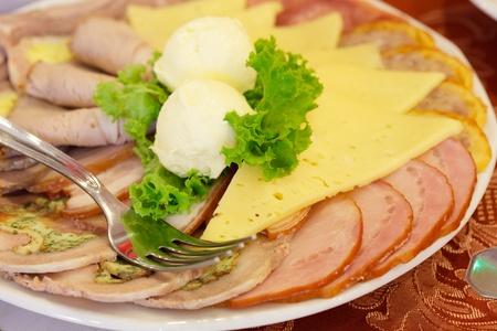collation: Various meat slices on white plate - collation