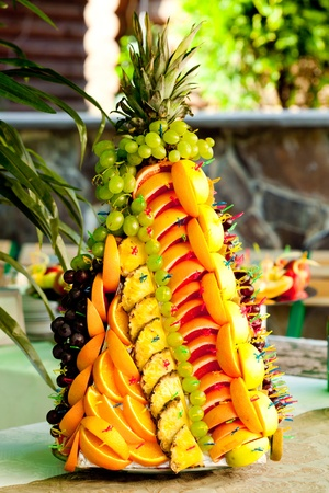 Various slices of fruits on the silver stand prepared for eating decored like form of pineapple Stock Photo - 10224233