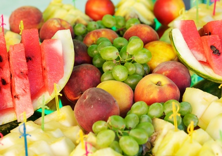 Vaus slices of fruits on the silver stand prepared for eating Stock Photo - 10224228