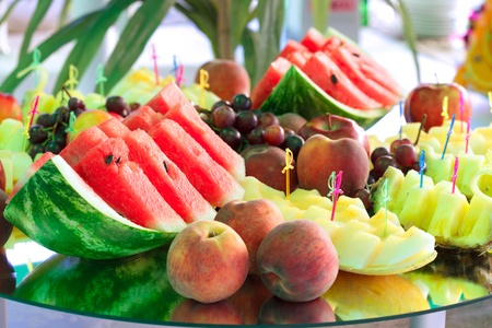 Various slices of fruits on the mirror stand prepared for eating Stock Photo - 10224218