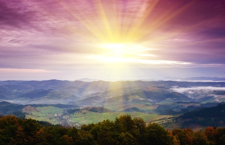 sunset sunrise: Sunrise in misty morning and village view Stock Photo
